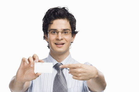 rfbatch15: Portrait of a businessman showing a blank business card