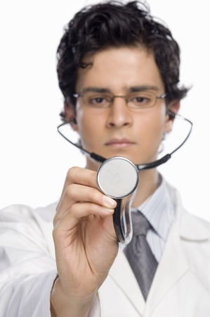 rfbatch15: Male doctor holding a stethoscope