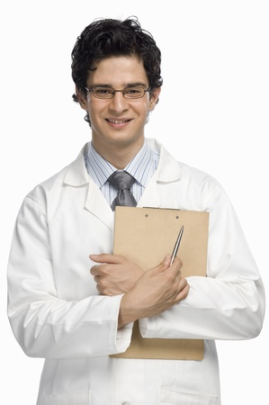 Portrait of a male doctor holding a clipboard