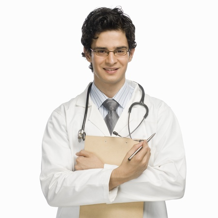 photosindia: Portrait of a male doctor holding a clipboard