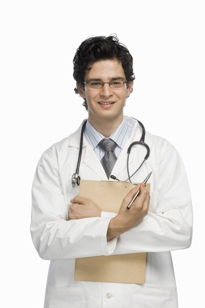 Portrait of a male doctor holding a clipboard Stock Photo - 10123616