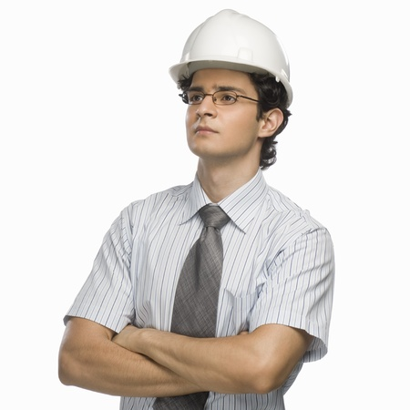 photosindia: Close-up of a male architect with his arms crossed