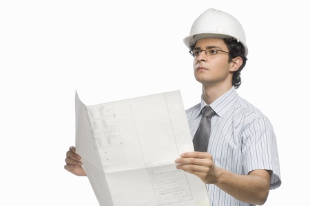 Male architect holding a blueprint Stock Photo - 10126270