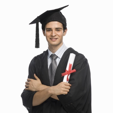 Portrait of a happy male graduate holding his diploma Stock Photo - 10123528