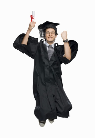 excellent: Happy male graduate holding his diploma and jumping LANG_EVOIMAGES