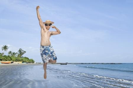 photosindia: Man jumping on the beach