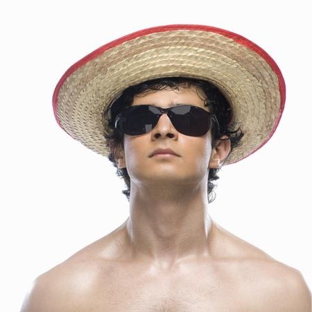 photosindia: Close-up of a man wearing straw hat