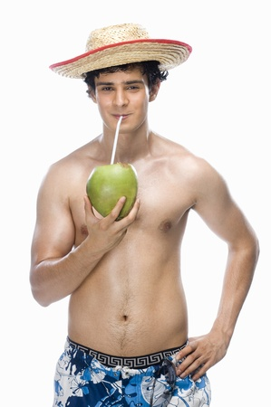 Man drinking coconut milk Stock Photo - 10126075