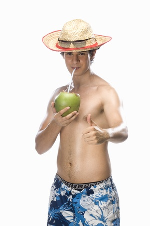 photosindia: Man drinking coconut milk and showing thumbs up LANG_EVOIMAGES