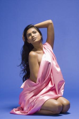 Female fashion model posing against blue background Stock Photo - 10124964