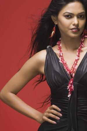 rfbatch15: Portrait of a female fashion model posing against red background