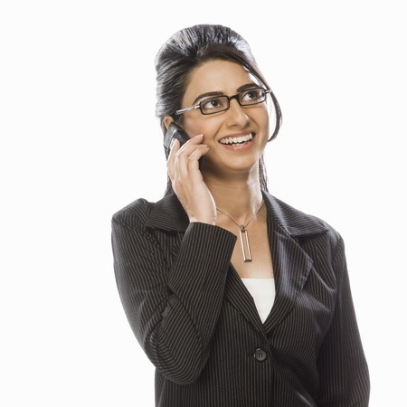 Businesswoman talking on a mobile phone Stock Photo - 10124191