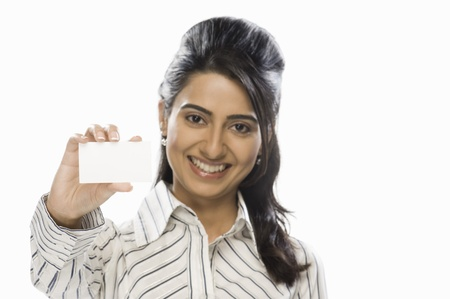 Businesswoman showing a blank card Stock Photo - 10123917
