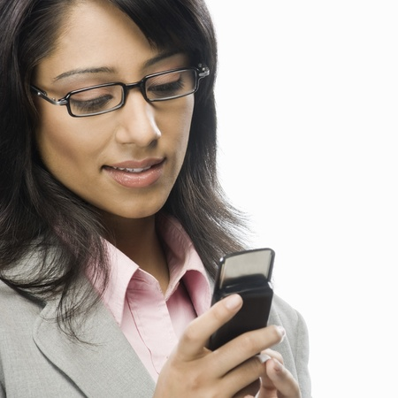 Businesswoman text messaging Stock Photo - 10125061