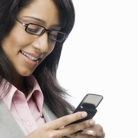 flip phone: Businesswoman text messaging