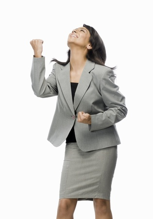 clenching: Businesswoman clenching her fist with joy