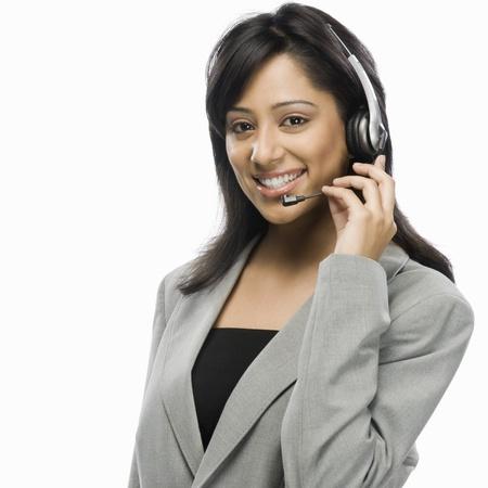customer service representative: Portrait of a female customer service representative smiling