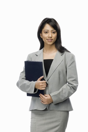 Portrait of a businesswoman holding a file