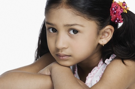 indian subcontinent ethnicity: Portrait of a girl resting her face on her hands