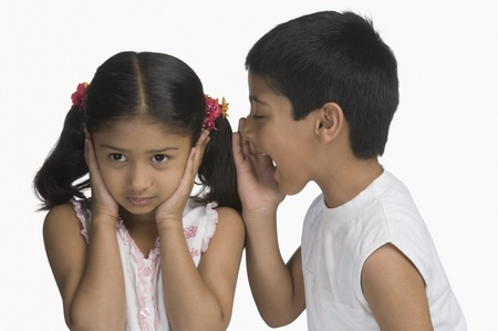 Girl covering her ears while her brother shouting Stock Photo - 10125120
