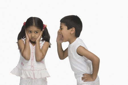 indian subcontinent ethnicity: Girl covering her ears while her brother shouting