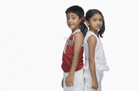 indian subcontinent ethnicity: Portrait of two children standing back to back