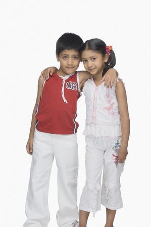 indian boy: Portrait of a boy and his sister arm around
