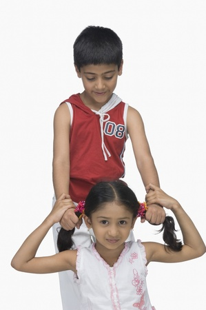 Boy pulling hair of his sister Stock Photo - 10125467