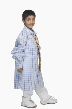 Portrait of a boy wearing oversized shirt and tie