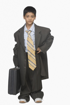oversize: Portrait of a boy wearing oversized suit and holding briefcase