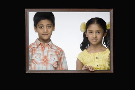 Portrait of a girl and a boy in a picture frame Stock Photo