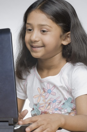 laptop: Close-up of a girl using a laptop