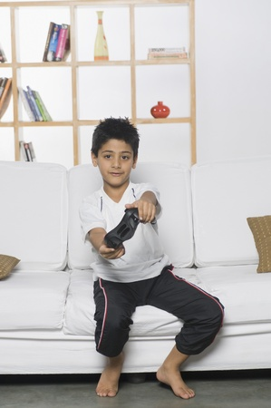 1 boy only: Boy playing handheld video game