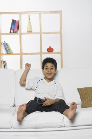Boy playing handheld video game Stock Photo - 10124472