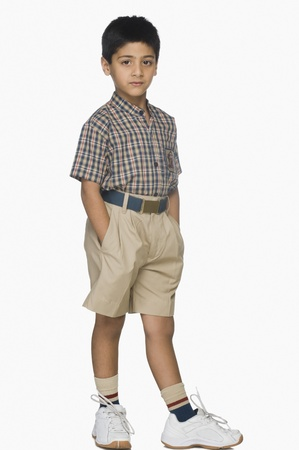 indian boy: Portrait of a boy standing with his hands in pockets