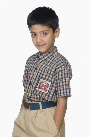 Portrait of a boy standing with his hands in pockets Stock Photo - 10124842