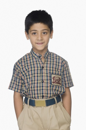 Portrait of a boy standing with his hands in pockets Stock Photo - 10124861