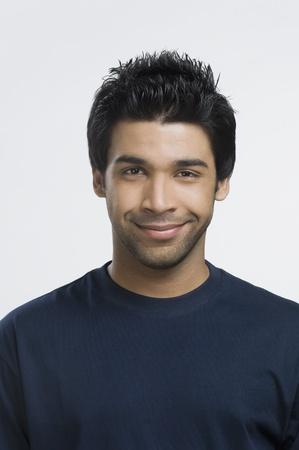 indian subcontinent ethnicity: Portrait of a man smiling LANG_EVOIMAGES