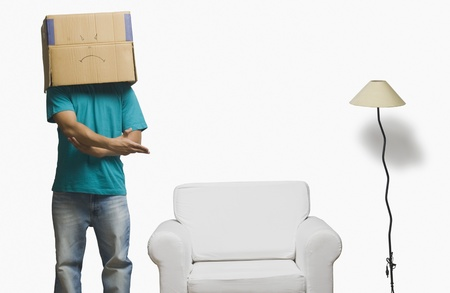 Man covering his face in a cardboard box and offering a seat Stock Photo - 10124034