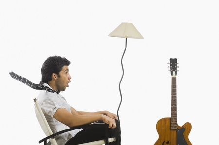Man sitting in a chair and looking surprised Stock Photo - 10123981