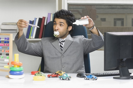behaving: Businessman behaving like a kid in an office