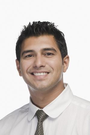 Portrait of a businessman smiling Stock Photo - 10124660