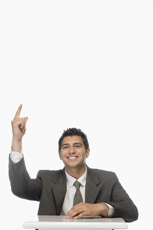 Portrait of a businessman indicating upward and smiling Stock Photo - 10123975