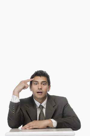 Portrait of a businessman thinking with his eyes wide open Stock Photo - 10125732