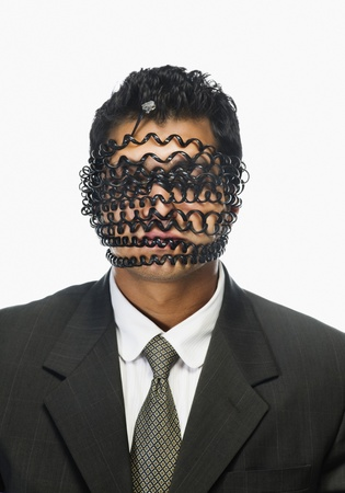 technophobe: Businessmans face wrapped with telephone cord LANG_EVOIMAGES