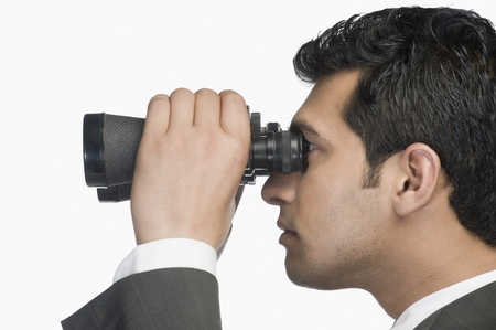 Businessman looking through binoculars Stock Photo - 10124674
