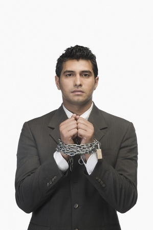 Portrait of a businessman locked with chains Stock Photo - 10124506