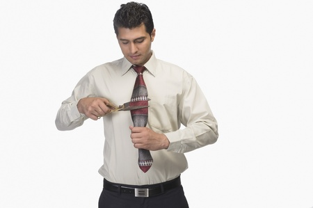 Businessman cutting his tie by scissors Stock Photo - 10123983
