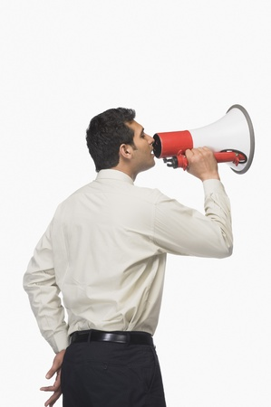 Businessman announcing into a megaphone Stock Photo - 10125805
