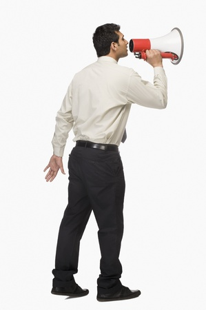 Businessman announcing into a megaphone Stock Photo - 10123941
